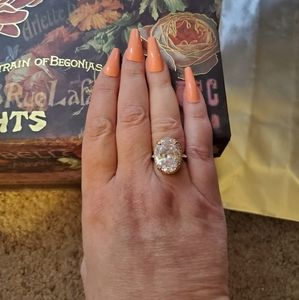 Rose Gold and Cubic Zirconia Oval Halo Ring.